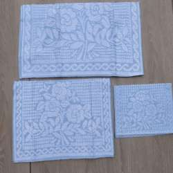 Juego de toallas en plano color azul